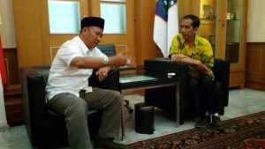Mukhlis Basri saat berbincang dengan Presiden Jokowi di sebuah kesempatan. Foto Istimewa